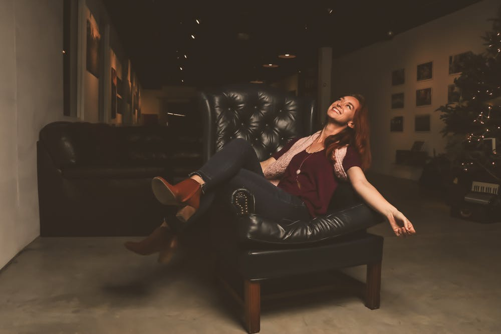 woman sitting in a leather lounge